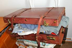 over packed suitcase 2